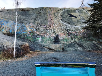 "Check out the wall painting, ""Yellowknife Cultural Crossroads"", which is created by artists Sonny MacDonald in 1999, and dedicated to all peoples of the North, like Metis, Dene, Inuvialuit, English Canadian, French Canadian, and Quebec."